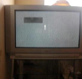 Glass TV stand with silver TV loads of videos with a video player £25 the lot