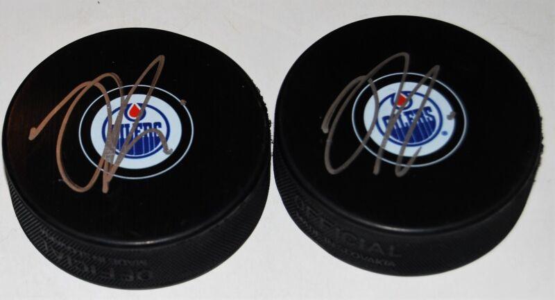 JESSE PULJUJARVI signed (EDMONTON OILERS) Souvenir autograph hockey Puck W/COA 2