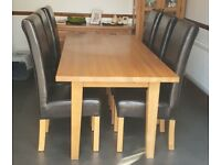 Solid oak dining table and 6 chocolate leather chairs