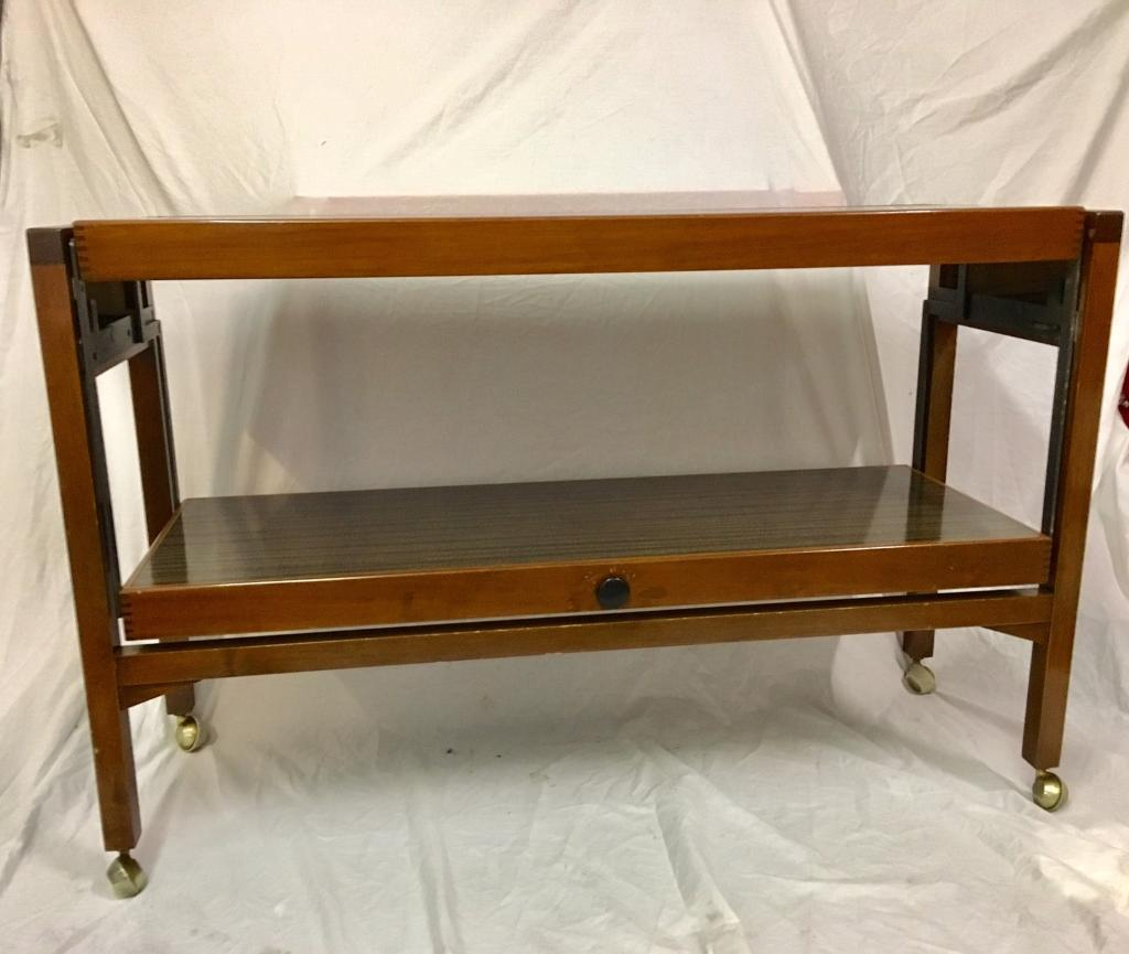 Metamorphic trolleytable, vintage, retro, 60s70sin Dromara, County DownGumtree - L 116cmW 38cmH 75cmTable top surface extended 76cm x 116cmBeautiful hard to find retro metamorphic trolley/table. Original condition, great space saver for any house. £60 ONO