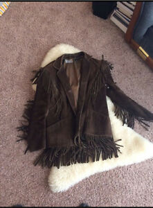 Vintage leather jacket with fringe.