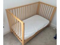 Ikea wooden cot. £25 Ono.