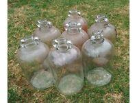 Seven used demijhons - one gallon capacity each