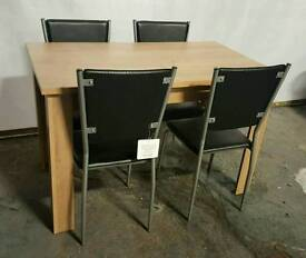 Oak dining table with black chairs (brand new)