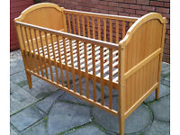 cot bed. can be changed into junior bed. with removable washable mattress. In good condition.