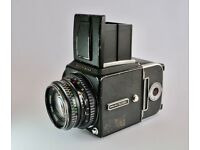 Hasselblad 500 c/m with Carl Zeiss Planar 80mm f2.8 lens and two A12 film backs