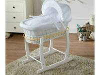 £35.Moses basket with rocking stand