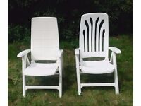 Reclining arm chairs, two substantial strong folding white plastic arm chairs.