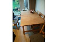 large, extendable solid wood dining table plus two chairs for sale