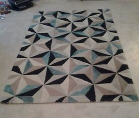 Large rug, 60% wool and 40% viscose, 150cmx 240cm in black, beige, cream and teal
