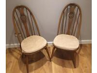 Pair of Ercol Swan high back dining chairs.