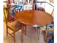 Stag Madrigal extending dining table and 4 chairs. Used bargain !
