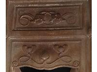 Art neaveau iron fireplace insert.