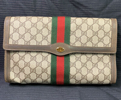 Authentic vintage Gucci monogram GG sherry brown monogram leather purse clutch