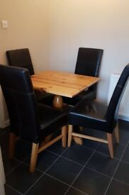 Square wooden table and 4 faux brown leather chairs