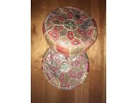 A pair of Vintage Distressed Moroccan Colorful Leather Pouf