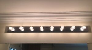 Two 8 lamp chrome vanity strip light fixtures - with bulbs
