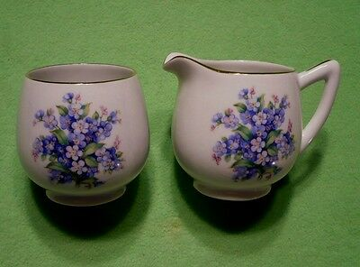 Vintage Schumann Arzberg sugar and creamer with vibrant BLUE FLOWER BOUQUETS.