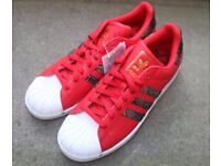 ADIDAS SUPERSTAR RED TRAINERS