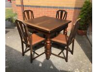 Vintage oak extendable dining table with four chairs