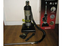 Upright bagless vacuum cleaner with hose and pet hair nozzle