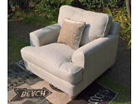 A New Light Grey/Silver Natural Fabric Material Snug Arm Chair.