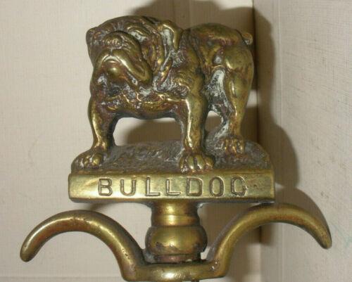 Rare antique brass Bulldog corkscrew wall hanging numbered 15297