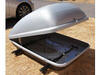 Grey Roof Box with Two Crossbars