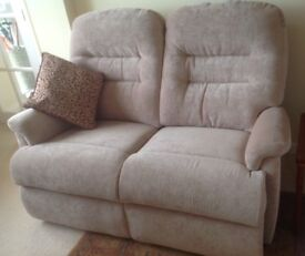 Two seater Sofa by Sherborne in as new condition.