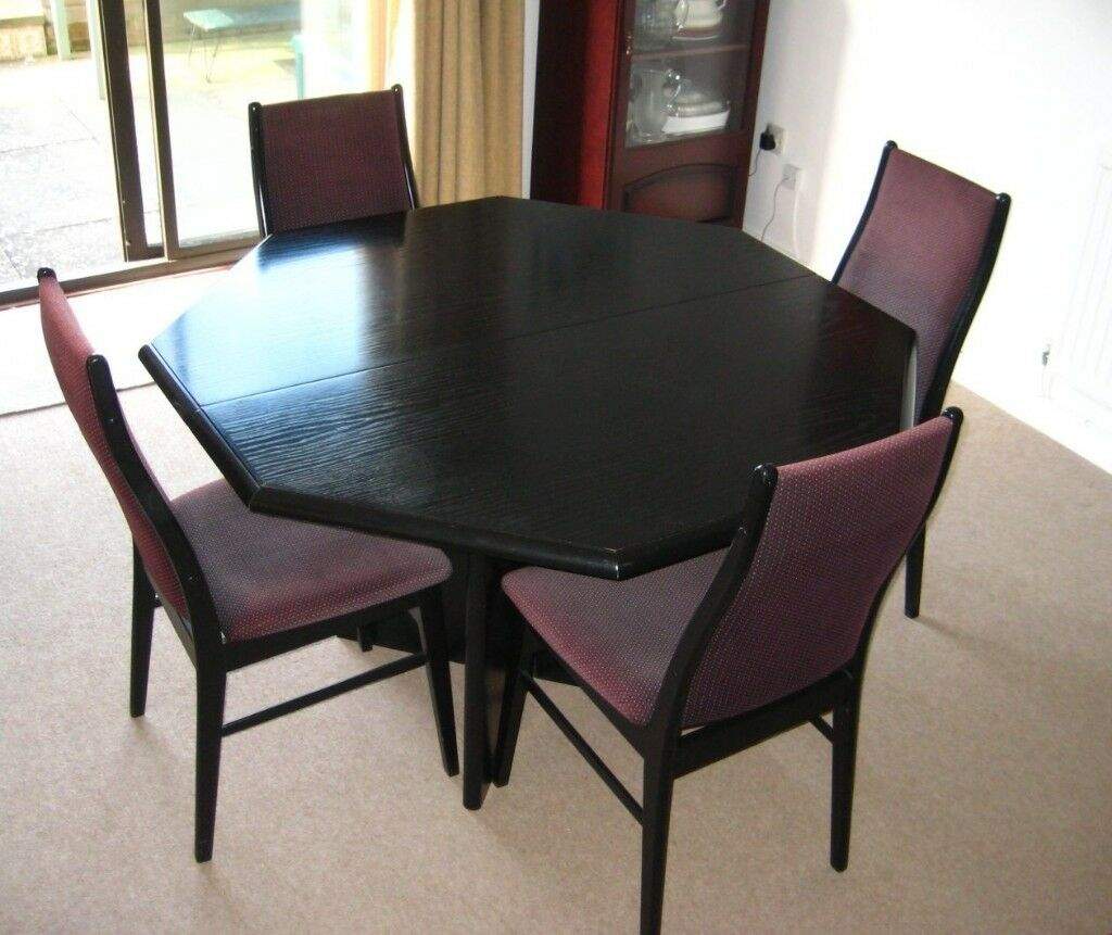 Black ash octagonal extending dining table and 8 chairs
