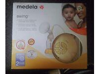 Medela Swing battery operated breast pump.