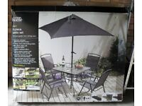 Patio Set. Opened but NEW and UNUSED - Table, Chairs & Parasol Set