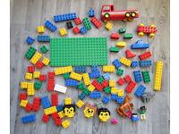 Lot of Lego Duplo bricks, animals, figurines, vehicles, flowers, heads