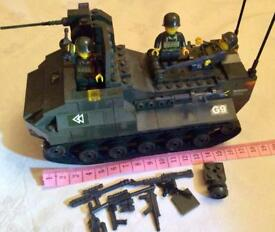 Building block plastic armoured car.