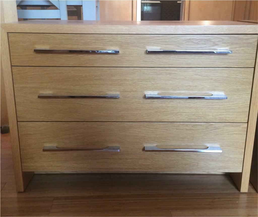 Pair of Michael Northcroft three drawer wide chest of drawers