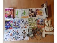 Nintendo wii 13 games with 5 controllers and wii fit board pick up only