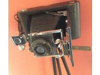 Large vintage camera on metal tripod,kodak.