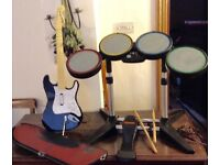 XBox drum kit, guitar and Wave rider Skateboard