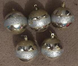5 gold and silver baubles