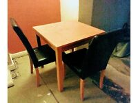 Square dining table with two chairs