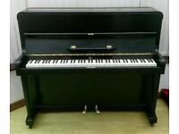 Black overstrung upright piano