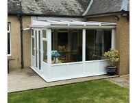 Double glazed white UPVC two-sided conservatory with French Doors in VGC