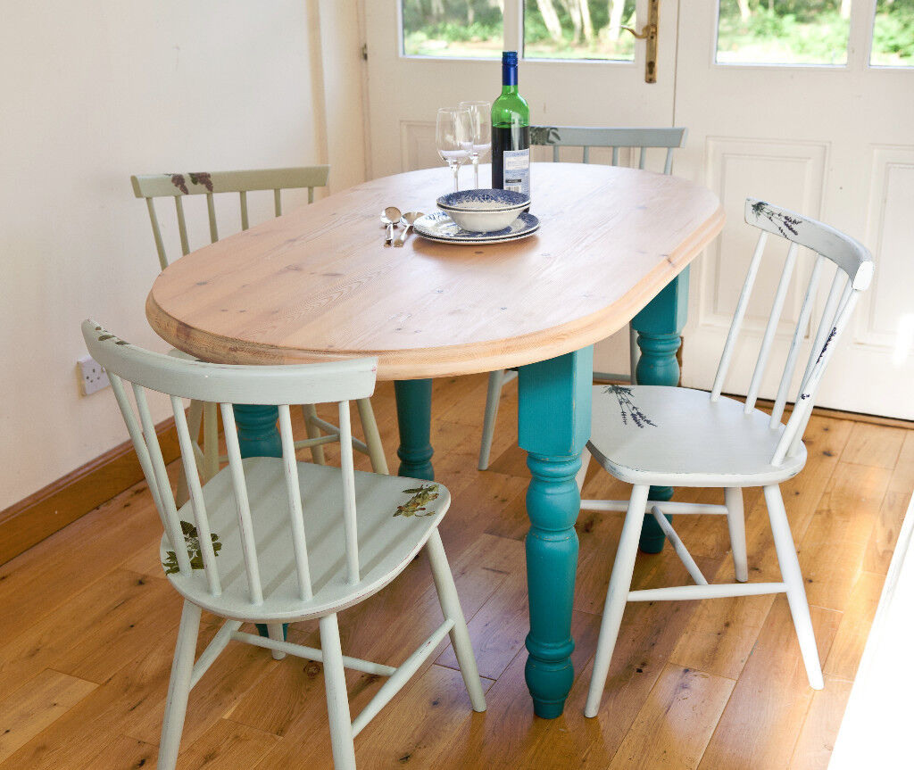 Oval pine country kitchen dining table with natural top and painted legs plus 4 chairs