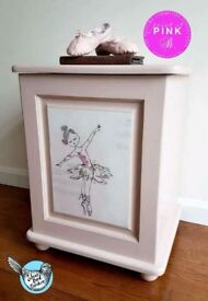 Toy / dressing up box with ballerina decoupaged onto front.