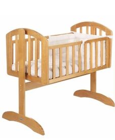 Swinging crib in natural in excellent condition (like new) with box. Musical mobile in box included