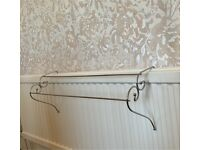 Two silver radiator clothes airer hangers