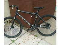 3 month old hybrid mountain bike. Only on road 2 times. In brand new condition