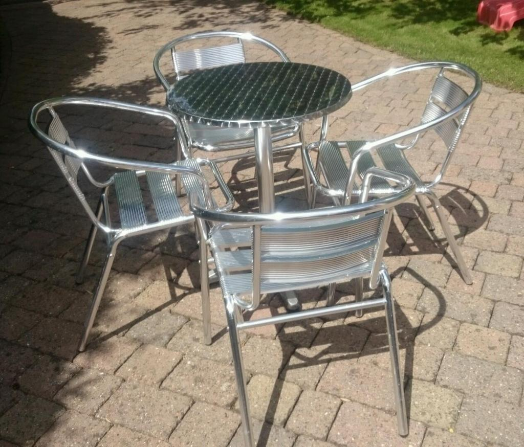 Aluminium Bistro Table and 4 Chairsin Quorn, LeicestershireGumtree - Aluminium bistro table and 4 aluminium arm chairs. Can be used indoors or outdoors and seats 2 to eat or 4 for drinks and snacks.The chairs stack for storage and the table has adjustable feet so it doesnt rock on an uneven surface.There is some...