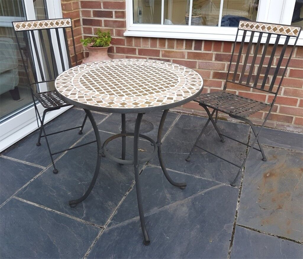 Small Pretty Mosaic Topped Garden Table And Two Folding Iron Chairs Also With