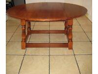 Very Nice Top Quality Vintage Oak Drop leaf Swivel Top Oval Coffee Table.